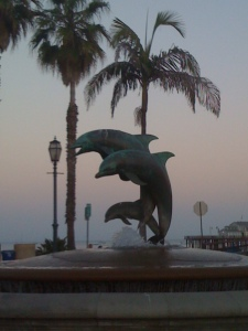 Where am I? (Hint: the dolphins are jumping from a pier.)